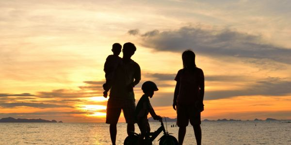 Silhouette image of a family by water | W8 Advisory | Family wealth management for African families